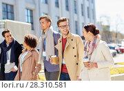 Купить «office workers with coffee on city street», фото № 28310581, снято 13 мая 2017 г. (c) Syda Productions / Фотобанк Лори