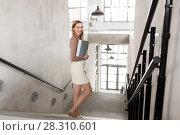 Купить «happy woman with folder walking downstairs», фото № 28310601, снято 25 февраля 2018 г. (c) Syda Productions / Фотобанк Лори