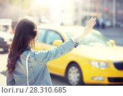 Купить «young woman or girl catching taxi on city street», фото № 28310685, снято 12 мая 2016 г. (c) Syda Productions / Фотобанк Лори