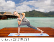 Купить «woman making yoga low angle lunge pose outdoors», фото № 28310721, снято 13 ноября 2015 г. (c) Syda Productions / Фотобанк Лори