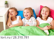 Купить «happy little kids having fun in bed at home», фото № 28310781, снято 15 октября 2017 г. (c) Syda Productions / Фотобанк Лори