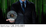 Купить «close up of businessman with bitcoin hologram», фото № 28310881, снято 6 сентября 2016 г. (c) Syda Productions / Фотобанк Лори
