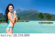 Купить «woman in bikini with drink on bora bora beach», фото № 28310889, снято 11 июля 2013 г. (c) Syda Productions / Фотобанк Лори