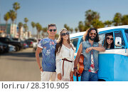Купить «hippie friends over minivan car at venice beach», фото № 28310905, снято 27 августа 2015 г. (c) Syda Productions / Фотобанк Лори