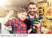 Купить «father and son with drill working at workshop», фото № 28310997, снято 14 мая 2016 г. (c) Syda Productions / Фотобанк Лори