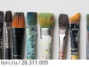 Купить «close up of dirty paintbrushes from top», фото № 28311009, снято 1 июня 2017 г. (c) Syda Productions / Фотобанк Лори