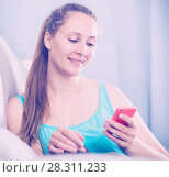 Купить «Woman using phone», фото № 28311233, снято 21 марта 2017 г. (c) Яков Филимонов / Фотобанк Лори