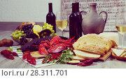 Купить «Still life with tasty seafood, wine, cheese and bread», фото № 28311701, снято 10 февраля 2018 г. (c) Яков Филимонов / Фотобанк Лори