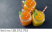 Купить «close up of fresh juices in mason jar glasses», видеоролик № 28312753, снято 8 апреля 2018 г. (c) Syda Productions / Фотобанк Лори