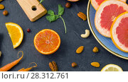 Купить «close up of fruits, nuts and vegetables on table», видеоролик № 28312761, снято 8 апреля 2018 г. (c) Syda Productions / Фотобанк Лори