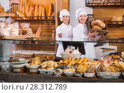 Купить «Portrait of friendly pleasant women at bakery display», фото № 28312789, снято 23 мая 2018 г. (c) Яков Филимонов / Фотобанк Лори