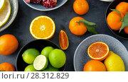 Купить «close up of citrus fruits on stone table», видеоролик № 28312829, снято 8 апреля 2018 г. (c) Syda Productions / Фотобанк Лори