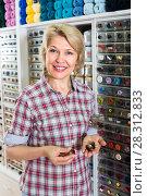 Купить «mature woman in sewing store», фото № 28312833, снято 23 мая 2019 г. (c) Яков Филимонов / Фотобанк Лори