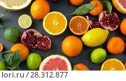 Купить «close up of citrus fruits on stone table», видеоролик № 28312877, снято 8 апреля 2018 г. (c) Syda Productions / Фотобанк Лори