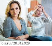 Купить «Mature mother and adult daughter quarrelling in domestic interior», фото № 28312929, снято 24 марта 2019 г. (c) Яков Филимонов / Фотобанк Лори