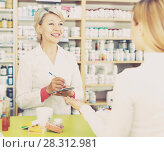 Купить «Seller helping customer to choose care products», фото № 28312981, снято 15 марта 2017 г. (c) Яков Филимонов / Фотобанк Лори