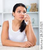 Купить «Young brunette woman wipes tears», фото № 28313021, снято 17 августа 2018 г. (c) Яков Филимонов / Фотобанк Лори