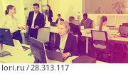 Купить «Business people working in open plan office», фото № 28313117, снято 10 марта 2018 г. (c) Яков Филимонов / Фотобанк Лори