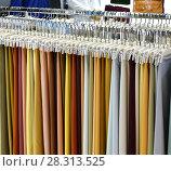 Купить «Fabric for sewing traditional Arabic clothing for men.», фото № 28313525, снято 9 апреля 2018 г. (c) Володина Ольга / Фотобанк Лори