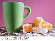 Купить «Апельсиновый рахат-лукум.  Восточные сладости лукум и большая зеленая чашка.», фото № 28313561, снято 18 апреля 2018 г. (c) ирина реброва / Фотобанк Лори