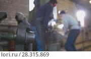 Купить «Blacksmith forging red hot iron on anvil - automatic hammering, de-focused», фото № 28315869, снято 17 июля 2018 г. (c) Константин Шишкин / Фотобанк Лори