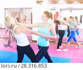 Купить «Female are training self-defence moves in pairs», фото № 28316853, снято 8 октября 2017 г. (c) Яков Филимонов / Фотобанк Лори