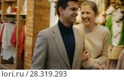 Купить «Couple is satisfied shopping and walking with package in the clothes store.», видеоролик № 28319293, снято 27 марта 2018 г. (c) Яков Филимонов / Фотобанк Лори