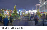 Купить «New Years celebration on Manezhnaya place in downtown rotation timelapse», видеоролик № 28323381, снято 17 января 2018 г. (c) Кирилл Трифонов / Фотобанк Лори