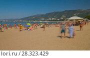 Купить «People rest on the sandy beach rotation  timelapse», видеоролик № 28323429, снято 14 сентября 2017 г. (c) Кирилл Трифонов / Фотобанк Лори
