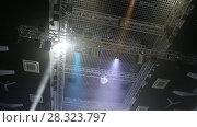 Купить «Stage lights. Soffits. Concert light. Silver mirror disco ball in the rays of the spotlights», видеоролик № 28323797, снято 21 апреля 2018 г. (c) Евгений Ткачёв / Фотобанк Лори