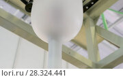 Купить «The process of blowing a polyethylene sleeve in an industrial extruder», видеоролик № 28324441, снято 12 апреля 2018 г. (c) Андрей Радченко / Фотобанк Лори