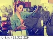 Купить «girl choosing handbag in store», фото № 28325229, снято 15 сентября 2016 г. (c) Яков Филимонов / Фотобанк Лори