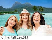 Купить «happy women over bora bora background», фото № 28326613, снято 4 июля 2013 г. (c) Syda Productions / Фотобанк Лори