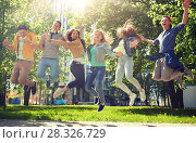 Купить «happy teenage students or friends jumping outdoors», фото № 28326729, снято 21 мая 2016 г. (c) Syda Productions / Фотобанк Лори