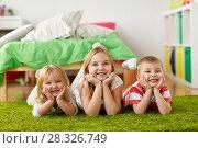 Купить «happy little kids lying on floor or carpet», фото № 28326749, снято 15 октября 2017 г. (c) Syda Productions / Фотобанк Лори