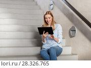 Купить «woman or student with tablet pc sitting on stairs», фото № 28326765, снято 25 февраля 2018 г. (c) Syda Productions / Фотобанк Лори