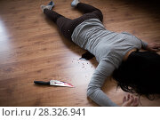 Купить «dead woman body lying on floor at crime scene», фото № 28326941, снято 5 мая 2017 г. (c) Syda Productions / Фотобанк Лори