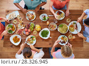 Купить «group of people eating at table with food», фото № 28326945, снято 5 октября 2017 г. (c) Syda Productions / Фотобанк Лори