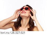 Купить «woman with red lipstick and heart shaped shades», фото № 28327021, снято 5 января 2018 г. (c) Syda Productions / Фотобанк Лори