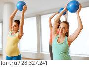 Купить «pregnant women training with exercise balls in gym», фото № 28327241, снято 5 марта 2016 г. (c) Syda Productions / Фотобанк Лори
