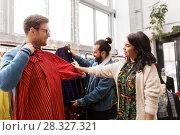 Купить «friends choosing clothes at vintage clothing store», фото № 28327321, снято 30 ноября 2017 г. (c) Syda Productions / Фотобанк Лори