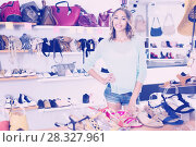 Купить «female in shoes showroom», фото № 28327961, снято 17 августа 2017 г. (c) Яков Филимонов / Фотобанк Лори