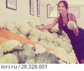 Купить «Woman seller wearing apron holding fresh cabbage head», фото № 28328001, снято 14 ноября 2018 г. (c) Яков Филимонов / Фотобанк Лори