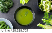 Купить «close up of vegetable green cream soup in bowl», видеоролик № 28328705, снято 14 апреля 2018 г. (c) Syda Productions / Фотобанк Лори