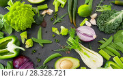 Купить «close up of green vegetables on stone table», видеоролик № 28328721, снято 14 апреля 2018 г. (c) Syda Productions / Фотобанк Лори