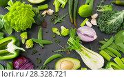 Купить «close up of green vegetables on stone table», видеоролик № 28328721, снято 14 апреля 2018 г. (c) Syda Productions / Фотобанк Лори