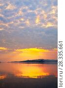 Купить «Lake Baikal in the spring. Beautiful morning light of the rising sun is reflected in the water», фото № 28335661, снято 30 мая 2010 г. (c) Виктория Катьянова / Фотобанк Лори
