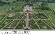Купить «Castle park Rundale in Latvia drone flight above trees, summer time», видеоролик № 28335837, снято 24 апреля 2018 г. (c) Aleksejs Bergmanis / Фотобанк Лори