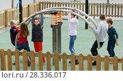 Купить «glad girl with long hair in school age sitting on swing on children's playground outdoors», фото № 28336017, снято 7 июля 2020 г. (c) Яков Филимонов / Фотобанк Лори