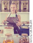 Купить «Young woman is offering nuts», фото № 28336201, снято 4 сентября 2017 г. (c) Яков Филимонов / Фотобанк Лори